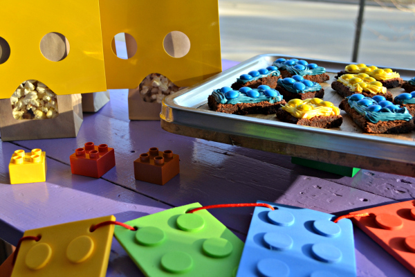 Simple LEGO Party on a budget. Lego figure popcorn bags, Lego brick brownies, and banner.
