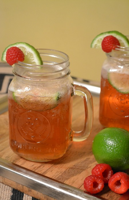 Raspberry moscow mule drink recipe, with fresh raspberries and lime.