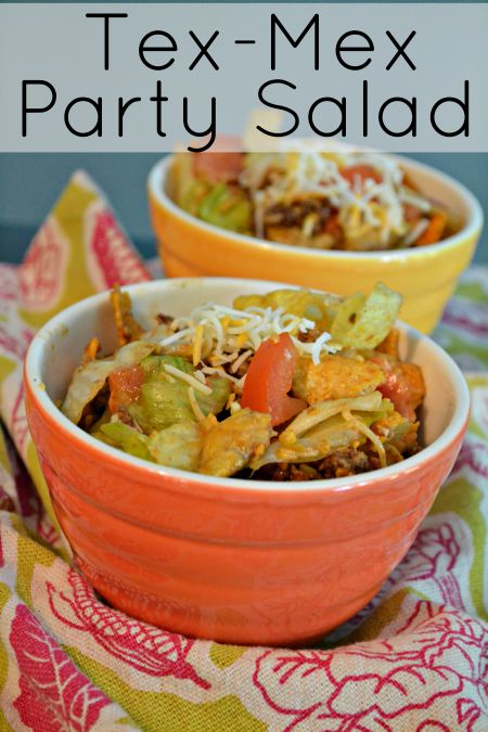 Doritos and BBQ Tex Mex Party Salad recipe. Your favorite chips mixed with taco meat and your favorite taco toppings and barbeque sauce. This is the best side dish for Summer parties.